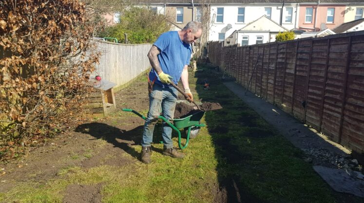 2 tons of fresh top soil brought in to level the lawn. Rolled it flat and get the levels right,